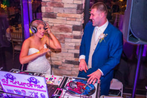 Davis Wedding | Rochester Wedding DJ | Ravenwood Country Club - bride and groom rockin out