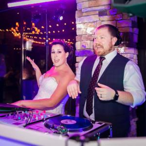 Sunderland Wedding | Ravenwood Golf Weddings | Rochester Wedding DJ - bride and groom on the turntables